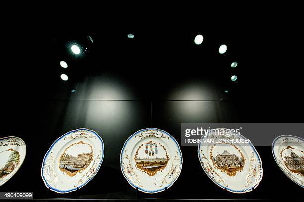 A picture shows dishes of the socalled Meissen tableware in the Rijksmuseum in Amsterdam on May 14 2014 Het Loo Palace the National Museum and three...