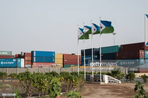 A picture shows Djibouti's national flags at the Doraleh Container Terminal in Djibouti on July 4 2018 East Africa's smallest country Djibouti...