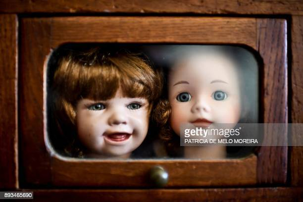 Picture shows doll heads inside a drawer at the Doll Hospital in Lisbon on December 12, 2017. - These delicate toys have been restored or collected...