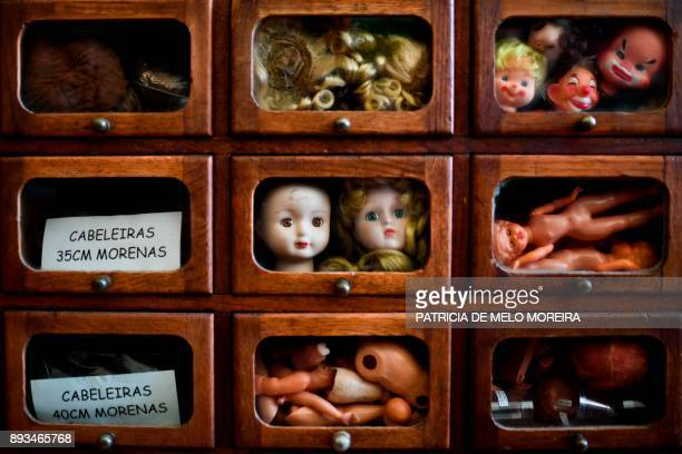 TOPSHOT A picture shows drawers with different doll parts at the Doll Hospital in Lisbon on December 12 2017 / AFP PHOTO / PATRICIA DE MELO MOREIRA