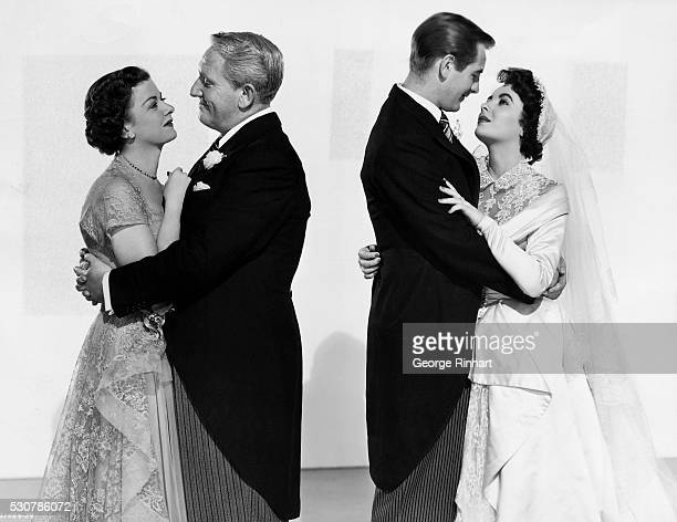 """Picture shows Elizabeth Taylor with Don Taylor and Joan Bennett and Spencer Tracy as her parents in the movie, """"Father of the Bride."""" While she was..."""