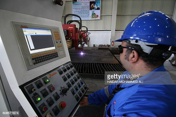 A picture shows employees working at the Siba oil field from Egypt's stateowned Petrojet in southern Iraq 30 kilometres southern of Basra on February...