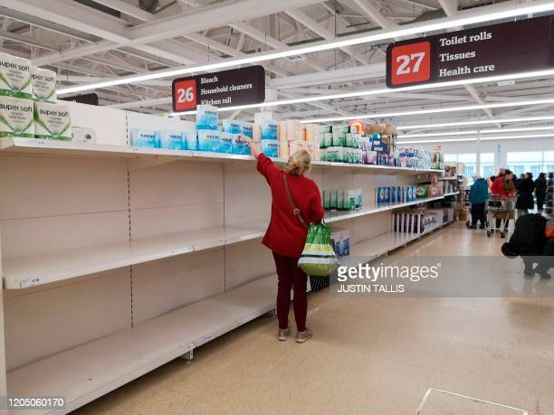 A picture shows empty shelves in the tissue paper aisle in a supermarket in London on March 4 2020 Large UK retailers are suffering supply...