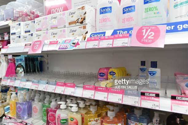 A picture shows empty shelves where hand sanitiser gels have sold out in a drug store in London February 4 2020 Pharmacies and drug stores say they...