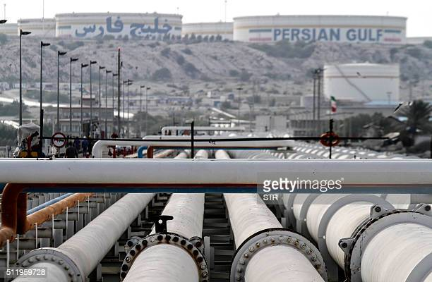 A picture shows export oil pipelines at an oil facility in the Khark Island on the shore of the Gulf on February 23 2016 Iran's Oil Minister Bijan...
