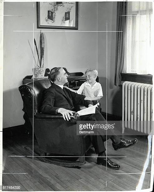 Picture shows Father Edward Joseph Flanagan founder of Boy's Town seated with one of his boys Undated photo