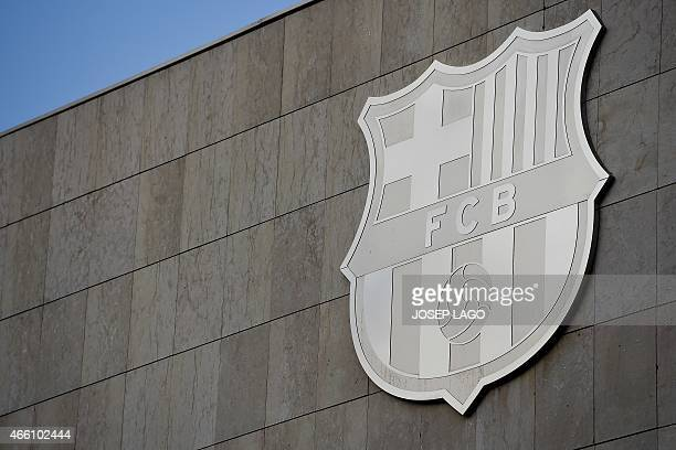 Picture shows FC Barcelona's badge displayed on a wall of the Camp Nou stadium in Barcelona on March 13 2015 A Spanish judge today upheld a tax fraud...