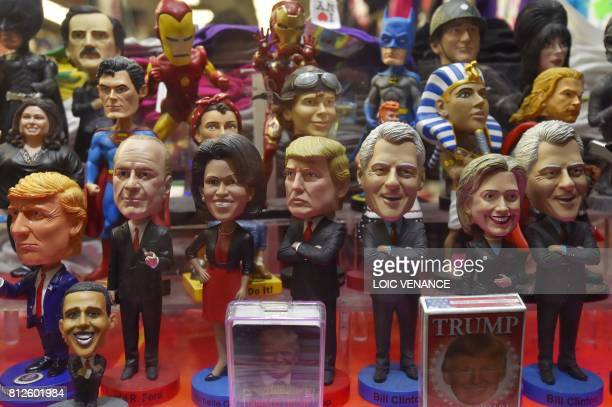 A picture shows figurines of Donald Trump former presidents and US super Heros in the window of a store downtown Manhattan on July 4 2017 in New York...