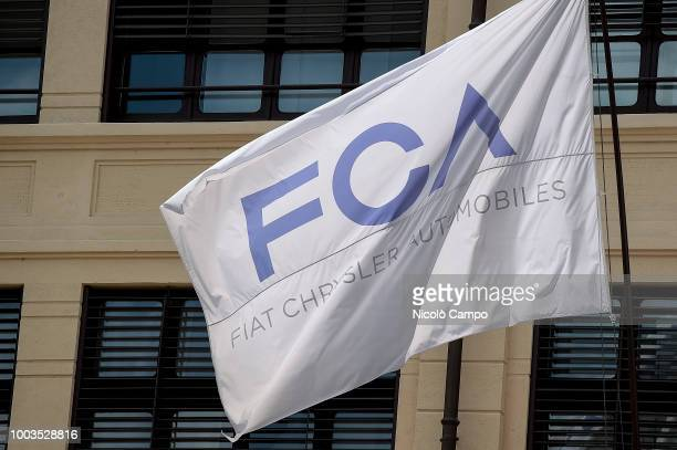 A picture shows flag of the Fiat Chrysler Automobiles in former Fiat historic building 'Lingotto' On July 21 FCA board discuss succession of CEO...
