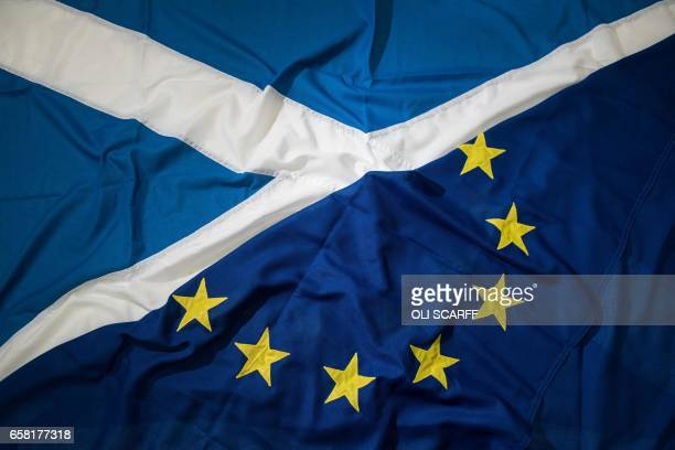 A picture shows flags arranged as an illustration a Saltire the national flag of Scotland and a European Union flag at the factory of 'Flagmakers' in...