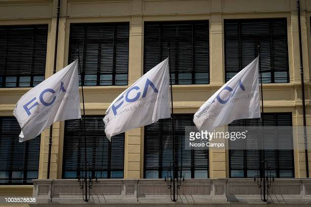 A picture shows flags of the Fiat Chrysler Automobiles in former Fiat historic building 'Lingotto' On July 21 FCA board discuss succession of CEO...