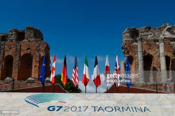 A picture shows flags on the stage of the ancient Greek Theater where Heads of State and of Government of the G7 the group of most industrialized...