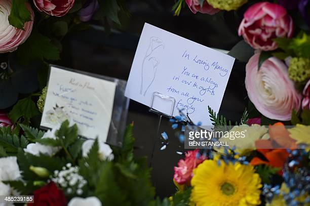 A picture shows floral tributes placed at the spot where British police officer Yvonne Fletcher was killed during a remembrance service to mark the...