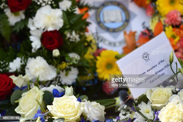 A picture shows floral tributes placed at the spot where British police officer Yvonne Fletcher was killed following a remembrance service to mark...