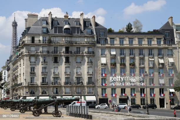 A picture shows French national flags on the buildings near the Invalides during a tribute ceremony to French filmmaker and writer Claude Lanzmann on...