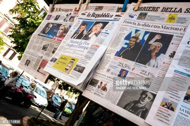 A picture shows front pages of Italian newspapers reporting on results of the first round of France's presidential electionon April 24 2017 in Rome...
