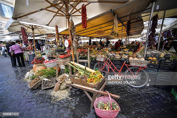 A picture shows fruits and vegetables on a stall at the Campo di Fiori food market in central Rome on November 4 2014 AFP PHOTO / ANDREAS SOLARO