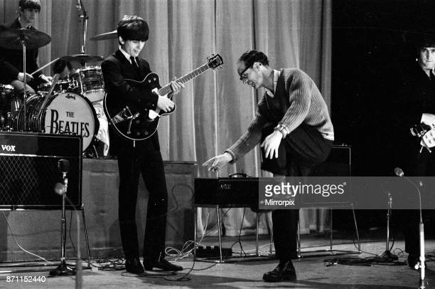 Picture shows George Harrison centre of The Beatles as they rehearse at The Prince of Wales Theatre in London for The Royal Variety Command...