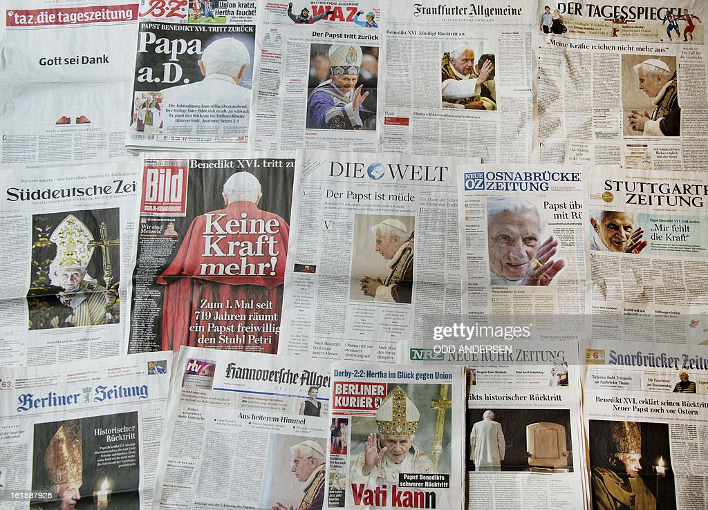 A picture shows German newspapers covering the resignation of Pope Benedict on their front pages on February 12, 2013. The pope's brother said on Monday he has known 'for a few months' that Benedict XVI was planning to resign and confirmed that the 85-year-old pontiff was 'feeling the burden of his age'.