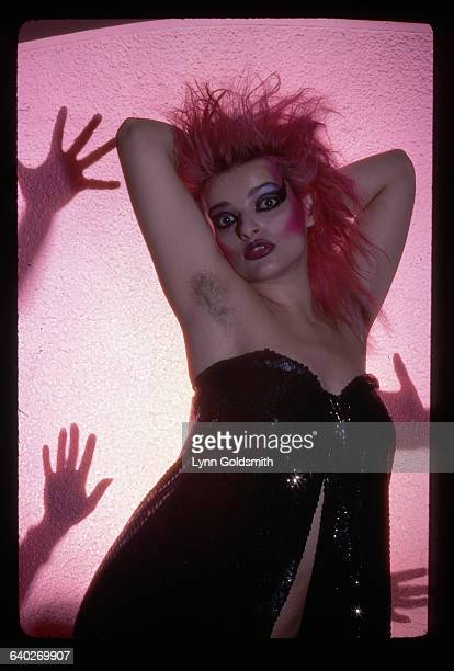 1980 Picture shows German punk singer Nina Hagan posing in black sequins dress pink hair and typical punk style makeup Her hands are placed behind...