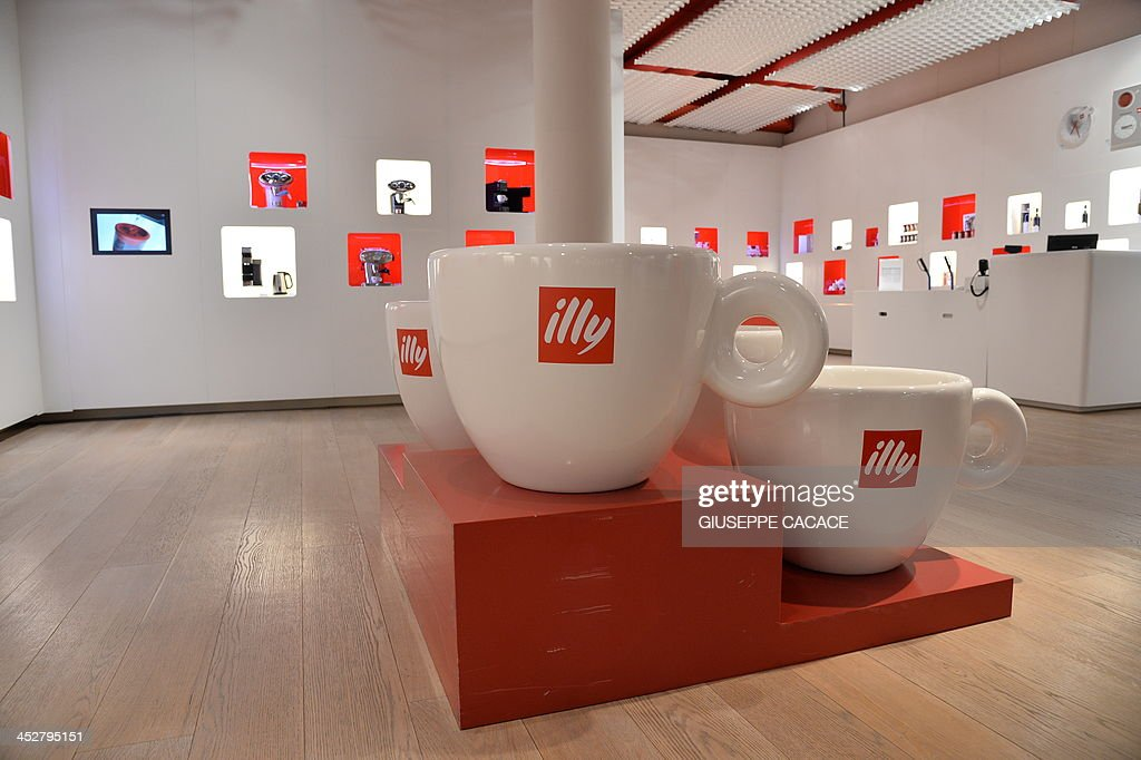 A picture shows giant cups of coffee in the show room at the Illy caffe  plant