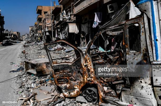 A picture shows heavily damaged buildings in Raqa on October 21 after a Kurdishled force expelled Islamic State group fighters from the northern...