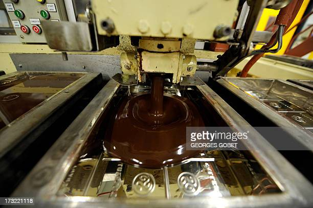Picture shows hot chocolate being moulded at the Barry Callebaut chocolate factory in Wieze, Belgium, on July 8, 2013. The industrial group Barry...