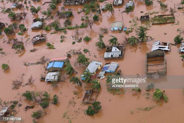 Picture shows houses in a flooded area of Buzi, central Mozambique, on March 20 after the passage of cyclone Idai. - International aid agencies raced...