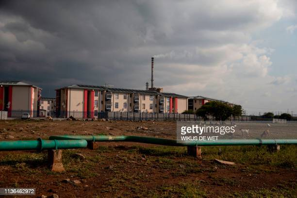 Picture shows housing for miners as the Lonmin platinum mine is seen in the background in Marikana on April 12, 2019.