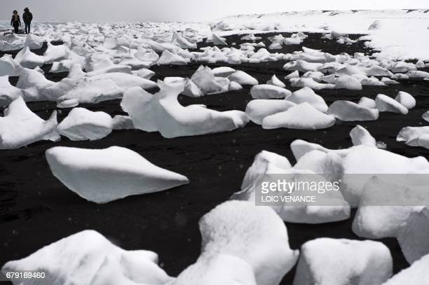 TOPSHOT A picture shows ice on a beach of the Jokulsarlon lagoon in the Austurland region in Iceland on taken on April 13 2017
