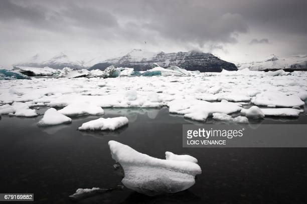 A picture shows icebergs in the Jokulsarlon lagoon in the Austurland region in Iceland on taken on April 13 2017 / AFP PHOTO / LOIC VENANCE