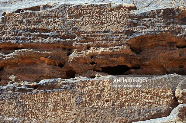 A picture shows inscription on a rosecoloured sandstone mountain in the Nabataean archaeological site of alHijr near the northwestern town of alUla...
