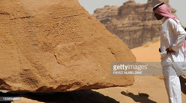 A picture shows inscription on rosecoloured sandstone in the Nabataean archaeological site of alHijr near the northwestern town of alUla Saudi Arabia...