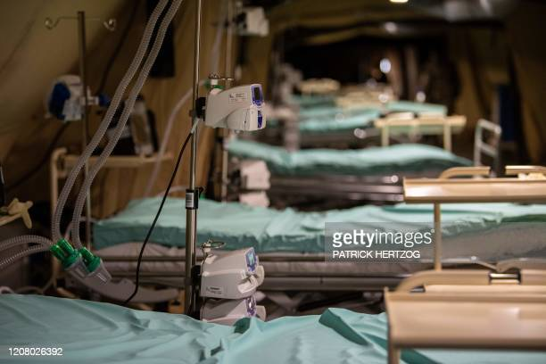 TOPSHOT A picture shows intensive care units with respiratory aid machines set up under a tent at a military field hospital at the Emile Muller...