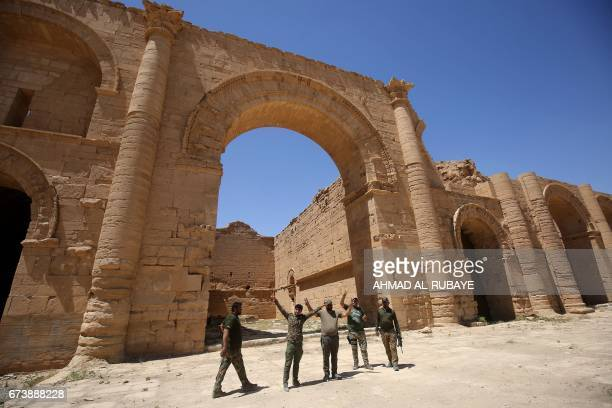 A picture shows Iraqi government forces celebrating at the UNESCOlisted ancient city of Hatra south of Mosul on April 27 2017 Iraqi forces retook the...