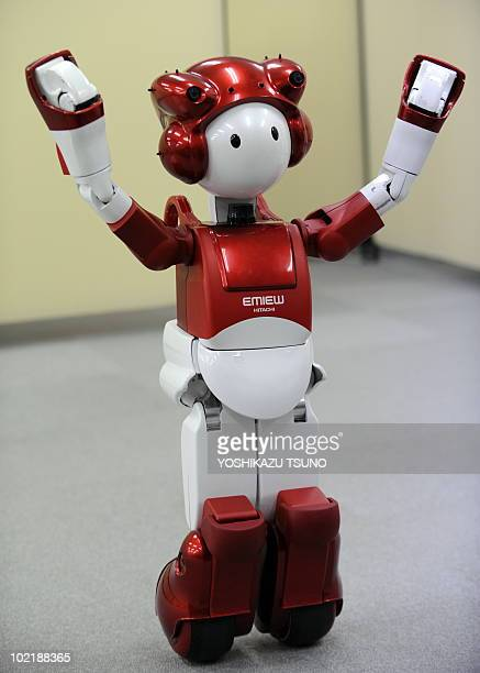 """Picture shows Japan's electronics giant Hitachi's humanoid robot """"Emiew2"""", 80cm tall and weighing 14kg, which can move over uneven ground and small..."""