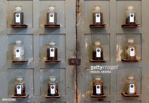 A picture shows jars on wall dedicated to 'Shit in the medicine of antiquity' on march 28 2017 at the Shit Museum in the Castelbosco castle of...