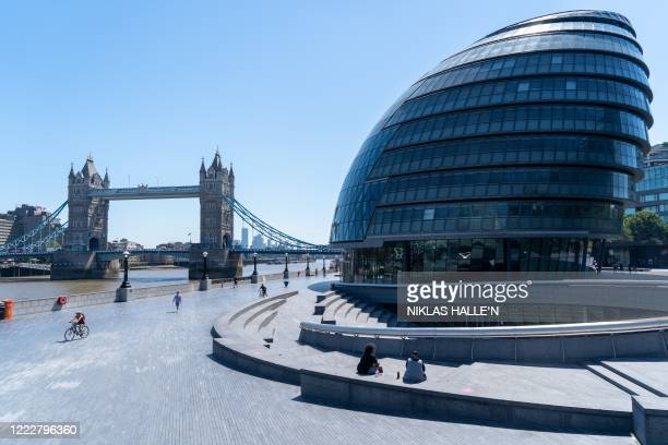 Picture shows London's City Hall, situated on the south bank of the River Thames with Tower Bridge seen in teh background in London on June 25, 2020....
