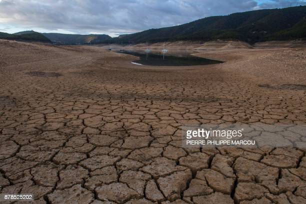 A picture shows low water levels at a reservoir in droughtstricken Entrepenas near Sacedon on November 24 2017 Spain and Portugal are grappling with...
