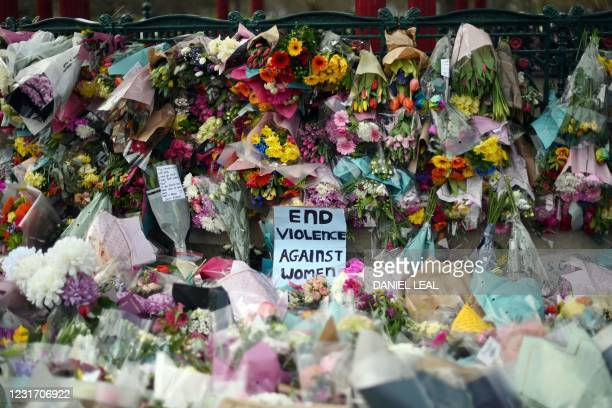 Picture shows messages and floral tributes left by well-wishers to honour alleged murder victim Sarah Everard at the bandstand on Clapham Common in...
