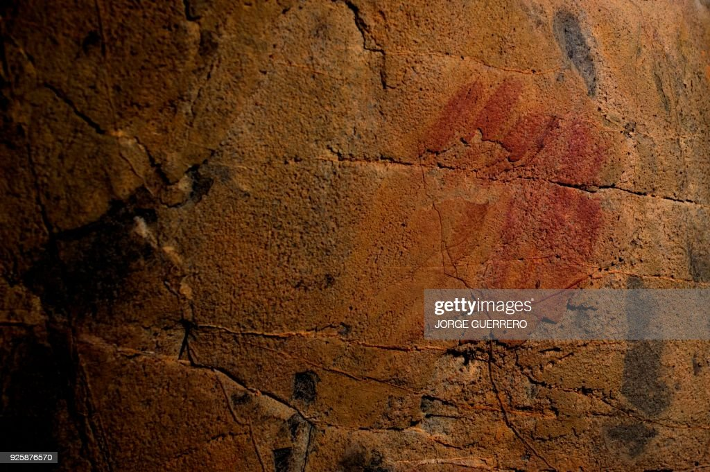 Picture shows neanderthal cave-paintings inside the Andalusian cave of Ardales, on March 1, 2018. The cave-paintings found in three caves in Spain, one of them in Ardales, were created between 43,000 and 65,000 years ago, 20,000 years before modern humans arrived in Europe, what could confirm that art was invented by the Neanderthals some 65,000 years ago. /