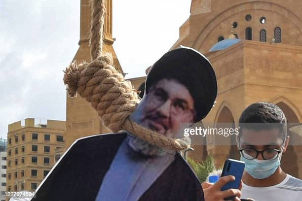 A picture shows noose with the portrait of Hassan Nasrallah the head of Lebanon's Shiite Muslim movement Hezbollah hung by Lebanese protesters in...