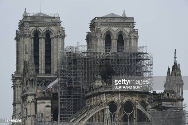 A picture shows NotreDame Cathedral in Paris on April 16 in the aftermath of a fire that caused its spire to crash to the ground Crowds of stunned...