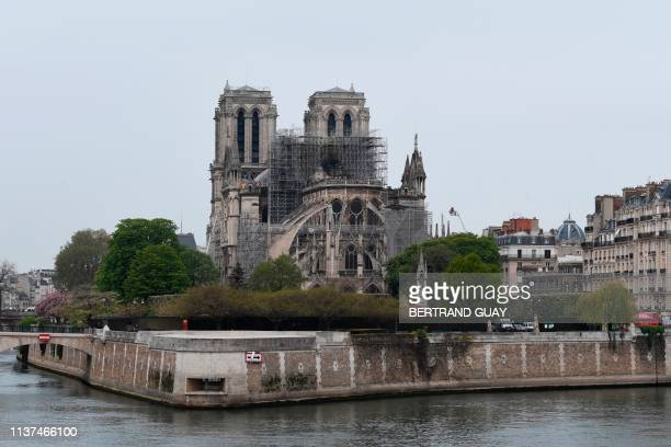 TOPSHOT A picture shows NotreDame Cathedral in Paris on April 16 in the aftermath of a fire that caused its spire to crash to the ground Crowds of...