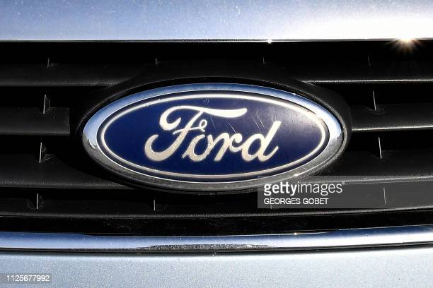 Picture shows on February 18 the logo of US auto-maker Ford on a car in Blanquefort, southwestern France. - French Economy Minister Bruno Le Maire...