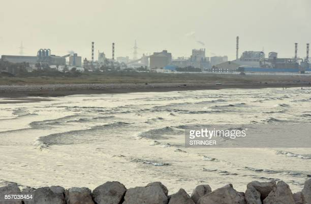 A picture shows on July 20 2017 the stateowned Tunisian Chemical Group 's phosphate processing plant close to the Chott Essalem beach and in front of...