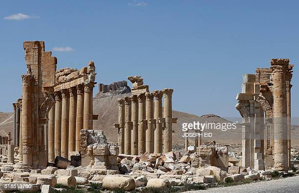 Picture shows on March 31, 2016 the remains of Arch of Triumph, also called the Monumental Arch of Palmyra, in the ancient Syrian city of Palmyra,...