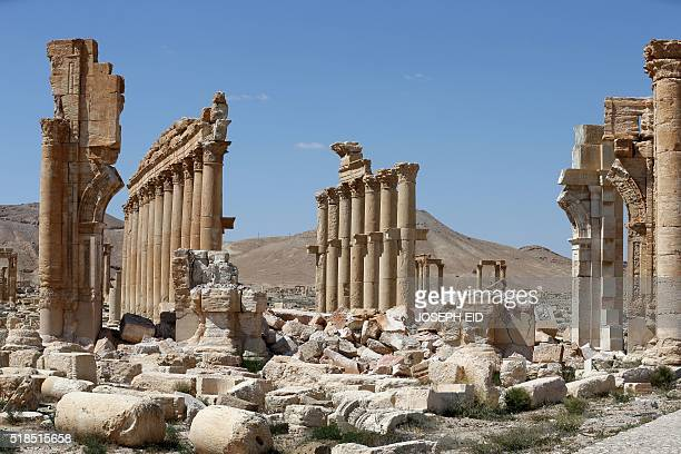 A picture shows on March 31 2016 the remains of Arch of Triumph also called the Monumental Arch of Palmyra in the ancient Syrian city of Palmyra...