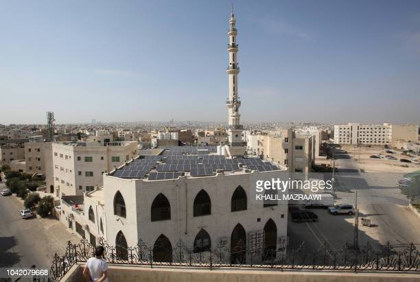 A picture shows on September 6 2018 a view of the Hamdan alQara mosque in southern Amman equiped with 140 solar panels on its roof Jordan imports...