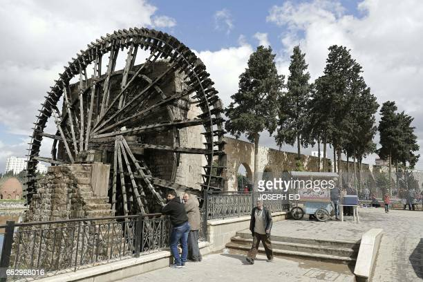 A picture shows one of the ancient water wheels or norias along the Orontes River in Hama in central Syria on March 13 2017 / AFP PHOTO / JOSEPH EID
